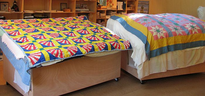 Two Quilts on Bed photo by Karen Alexander 700 x 330